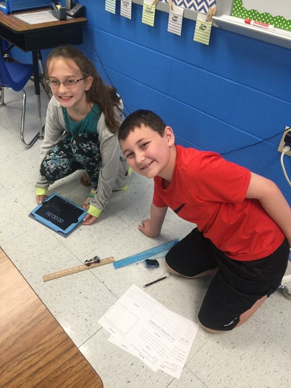 Pictures of students studying speed and energy