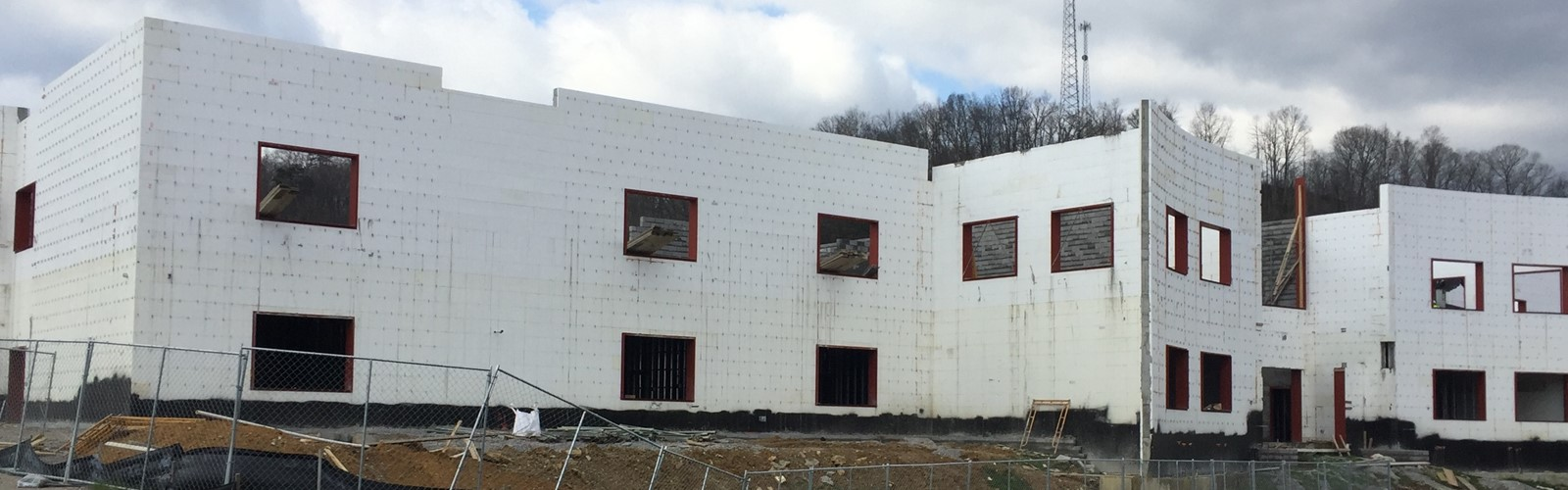 New High School Construction Left Side Front.  2 Story nestled against the hill side.