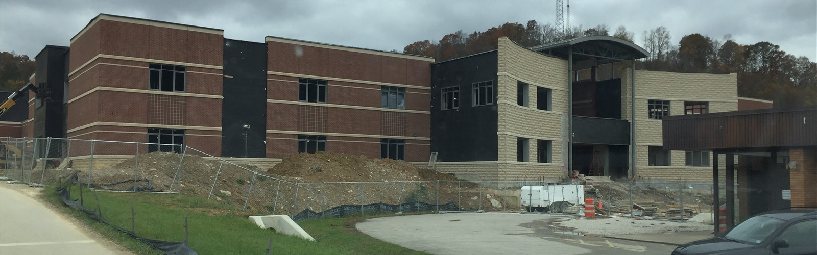 Front of the New High School building, windows going in.